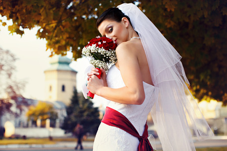 misterious: Bride looks misterious holding a wedding bouquet Stock Photo
