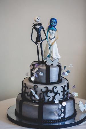 tier: Black gothic wedding cake decorated with figures of cartoons heroes