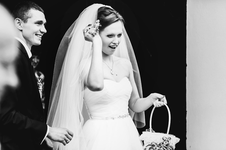 guests: Bride looks funny holding a basket of sweets for guests