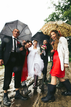 gumboots: Newlyweds have fun posing with friends in the gumboots