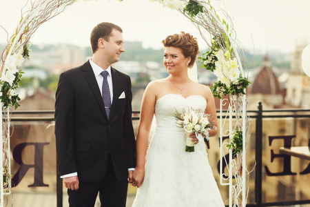Bride and groom look at each other with understanding during a ceremony Stock Photo