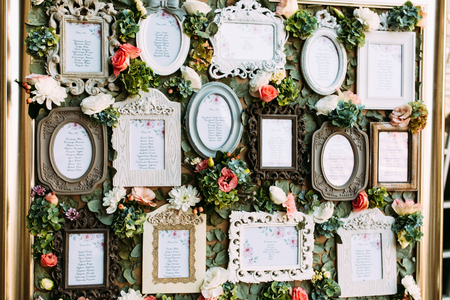 wedding reception decoration: Vintage frames with the list of the wedding guests Stock Photo