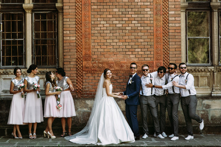 Married couple with the bridesmaids and groomsmen