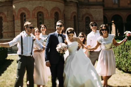 embracement: Couple with their bridesmaids and groomsmen Stock Photo