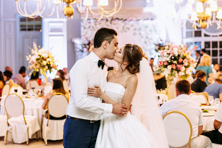 Kiss of the married couple in the luxury restaurant Stock Photo