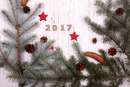 debt goals: Wooden number 2017 lies in a circle of fir branches Stock Photo