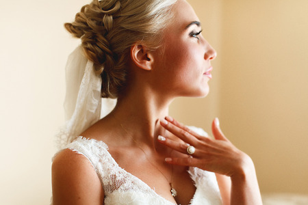 tenderly: Heavenly bride touches her neck tenderly