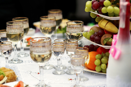 The buffet table with fruits and alcohol are near house Stock Photo