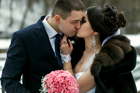 brunete: The lovely couple in love kissing in the park