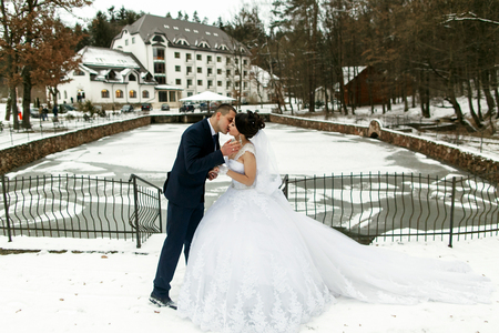 fiance: The brides kissing near frozen  lake