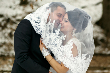 fiance: The brides embrace in the park
