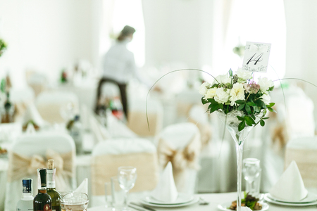 Table Number Stands In A Little Bouqet In A High Vase Stock Photo