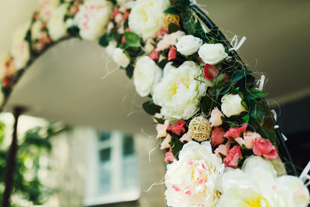 Wedding altar made of pink and white roses and decorated with greenery Stock Photo