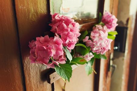 Pink nydrangeas decor a wooden door