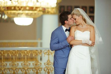 Groom is kissing his beautiful bride
