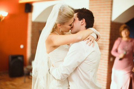 embracement: Passionate kiss of the newlyweds on the wedding party