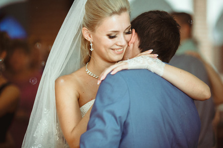 embracement: Amazing  first dance of the beautiful newlyweds on the wedding