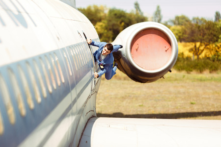 Crazy groom in the suit on the plane Stock Photo