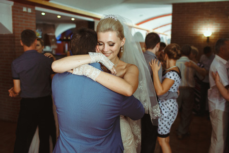 embracement: Romantic first dance of the newlyweds on the wedding Stock Photo