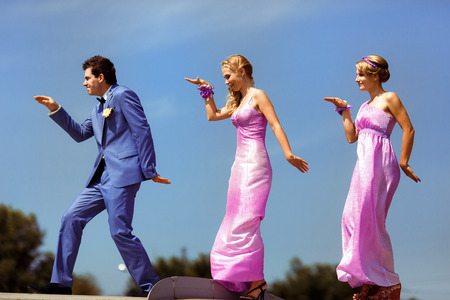 Funny groom with the two bridesmaids