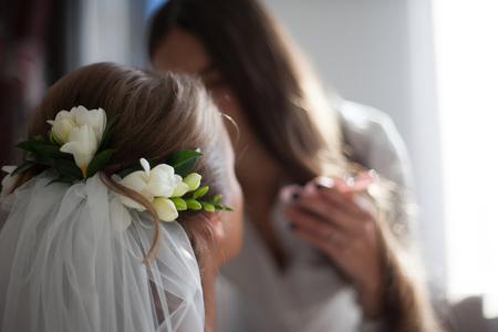 The make up artist doing make up for bride