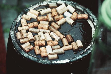Bottle corks float in a barrel Stock Photo