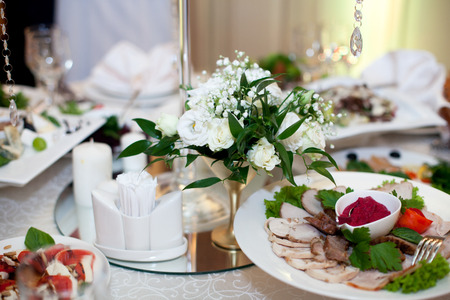 Little White Bouquets Stand In Steel Vases On The Wedding Dinner