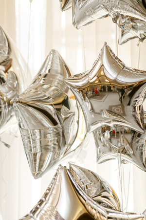 Restaurant hall reflecrs in the silver balloons
