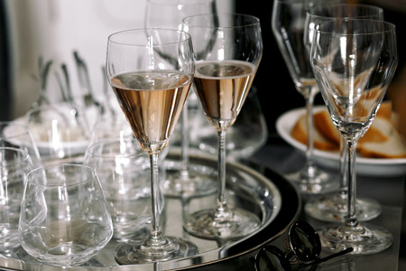 Original champagne flutes stand on a silver tray Stock Photo