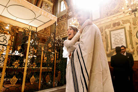 synagogues: Sun shines through the synagogues windows over happy newlyweds Stock Photo