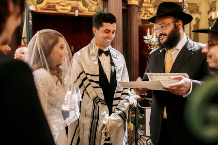 Old Jew holds a letter for wedding couple