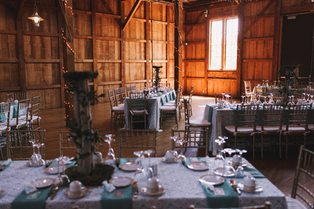 ceiling plate: Dinner tables prepared for wedding stand in a wooden hangar