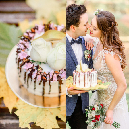 Groom holds tasty wedding cake while bride reaches his face for a kiss Stockfoto