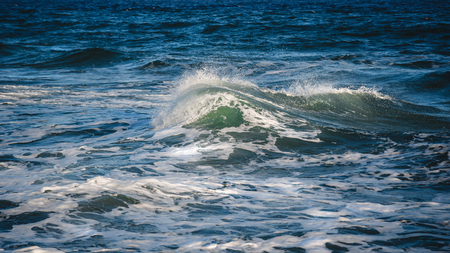 mare agitato: Close-up of a beautiful wave. Wave splash details abstract background