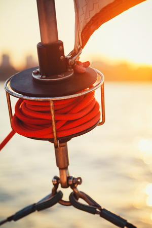 Sailboat winch, sail and nautical rope yacht detail. Yachting, marine background