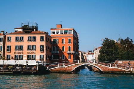 Venice, Italy - September, 9 2018: View of the bridge on Rio de S. Vio and a La Calcina Hotel from the Giudecca Canal