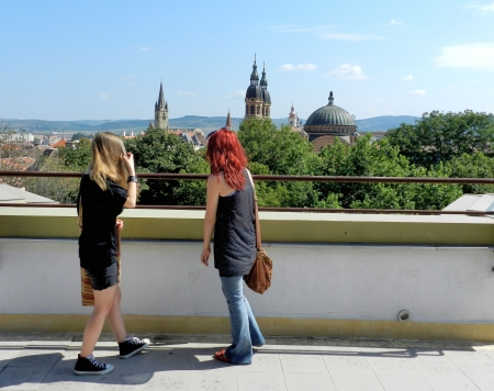 Blonde and Red Hair Girls Admiring Sibiu Roofs photo