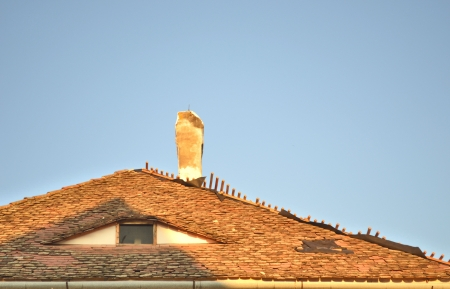 attic window: Old Roof with  A Chimney and A Triangular Attic Window