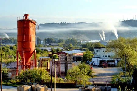 buidings: Industrial Landscape with Vermilion Tower and Smoke