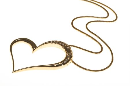 pendent: Golden Heart Shaped Necklace On White Background