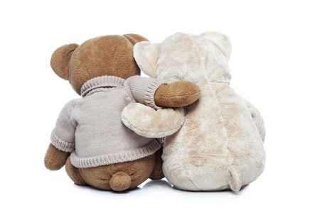 animals together: Back view of two Teddy bears hugging each other over white background