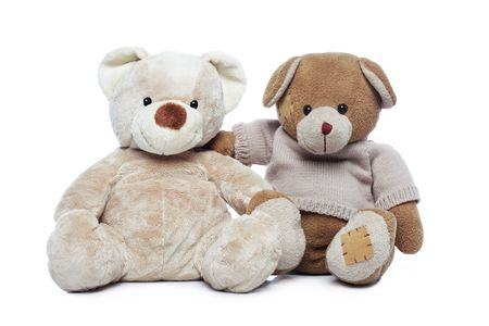 Two Teddy bears hugging each other over white background photo