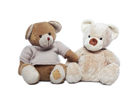 Two Teddy bears over white background photo