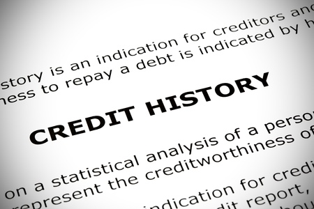 점수: CREDIT HISTORY heading printed on a white page with vignette effect 스톡 사진