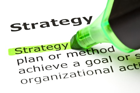 handbooks: The word Strategy highlighted in green with felt tip pen