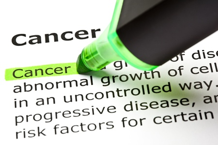 testicular cancer: The word Cancer highlighted in green with felt tip pen