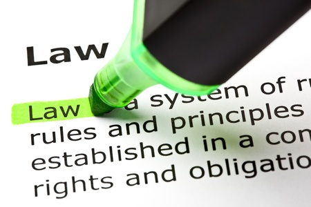 The word 'Law' highlighted in green with felt tip pen Stock Photo - 9619031