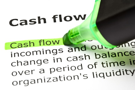 highlight: Cash flow highlighted in green with felt tip pen