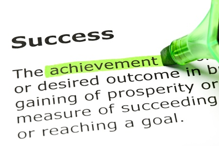 highlight: Achievement highlighted in green, under the heading Success Stock Photo