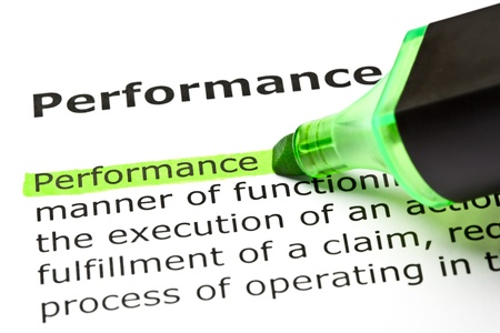 The word 'Performance' highlighted in green with felt tip pen Stock Photo - 9649127